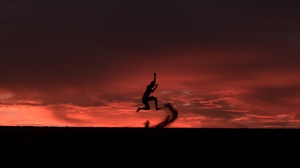 Preview wallpaper jump, night, silhouette, sunset