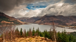 Preview wallpaper autumn, clouds, cloudy, fir-trees, gleam, lake, mountains, sky