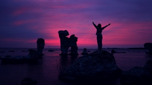 Preview wallpaper freedom, happiness, person, rocks, sea, sunset