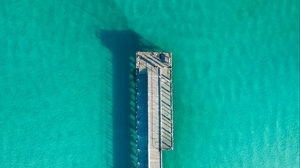Preview wallpaper ocean, pier, shadow, surface, top view, turquoise