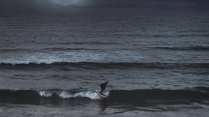 Preview wallpaper ocean, overcast, sea, surfer, surfing, waves