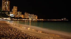 Preview wallpaper beach, city, coast, fires, night, sand, skyscrapers