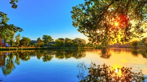 Preview wallpaper colors, decline, evening, krone, leaves, reflection, river, sun, tree, waves