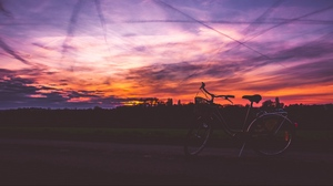 Preview wallpaper bicycle, road, sky, sunset