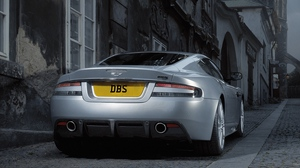 Preview wallpaper 2008, aston martin, building, cars, dbs, gray metallic, rear view, street, style