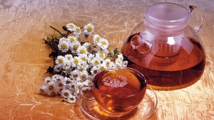 Preview wallpaper camomile, cup, decanter, drink, flowers, tea