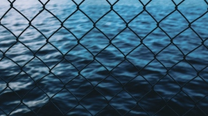 Preview wallpaper fence, grid, sea, water
