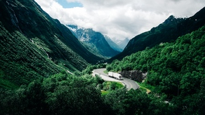 Preview wallpaper car, clouds, mountains, norway, road
