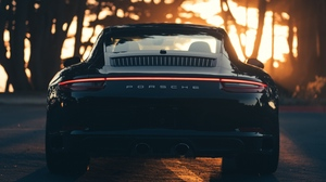 Preview wallpaper black, porsche, rear view, sports car, sunlight
