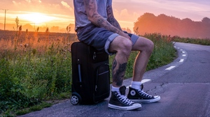 Preview wallpaper man, suitcase, sunset, tattoos