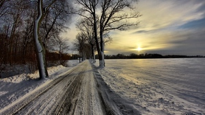 Preview wallpaper avenue, clouds, crust, protector, road, sky, snow, sun, winter