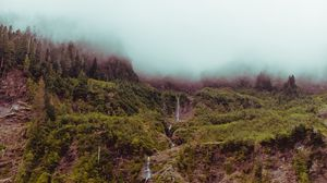 Preview wallpaper cliff, fog, mountain, sky, waterfall