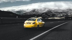 Preview wallpaper car, geely, rear view, road, yellow